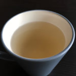 Closeup of ginger honey tea in a cup