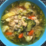 Chicken vegetable soup in a blue bowl