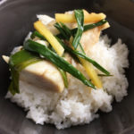 Fish with ginger and green onions on rice