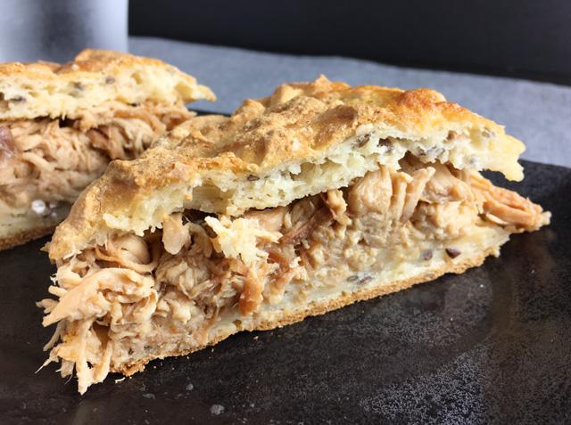 Slow Cooker Teriyaki Pulled Chicken in a bun, cut in half