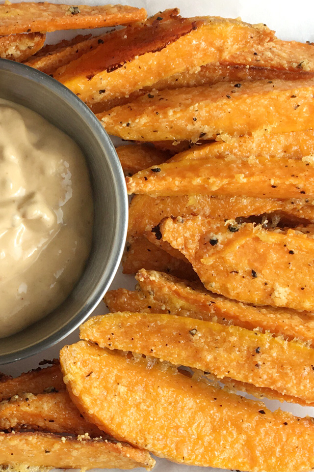 Close-up of Crispy Sweet Potato Fries with a dish of chipotle mayo