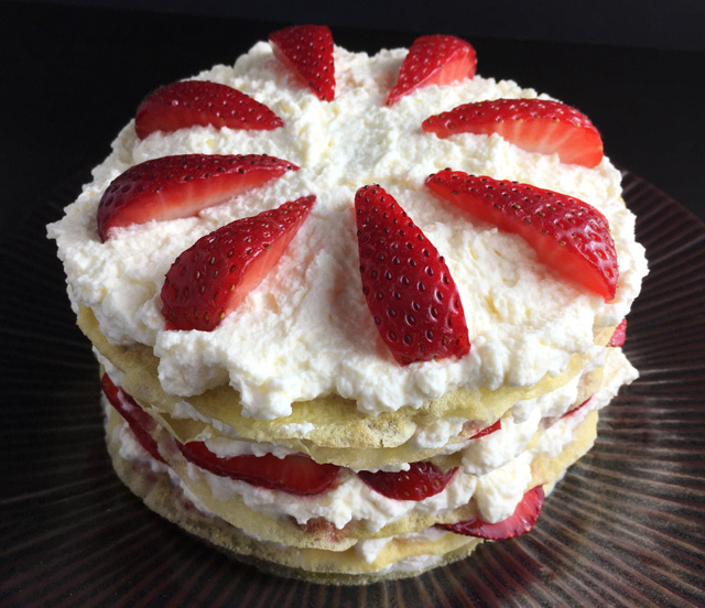 A whole Strawberry Cloud Crepe Cake with whipped cream