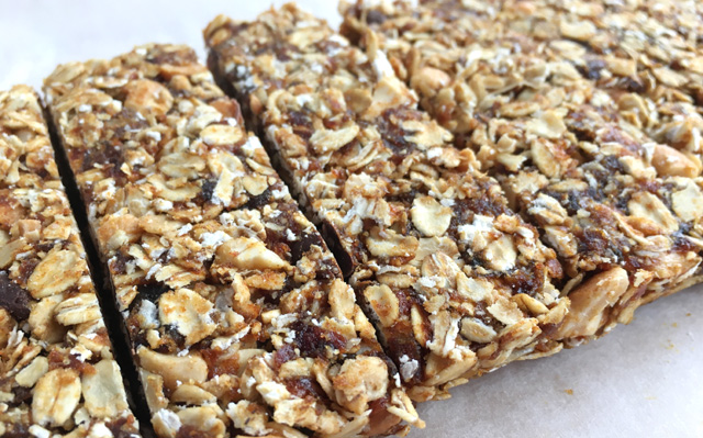 Cut up Simple Nutty Granola Bars with rolled oats, nuts, and chocolate chips
