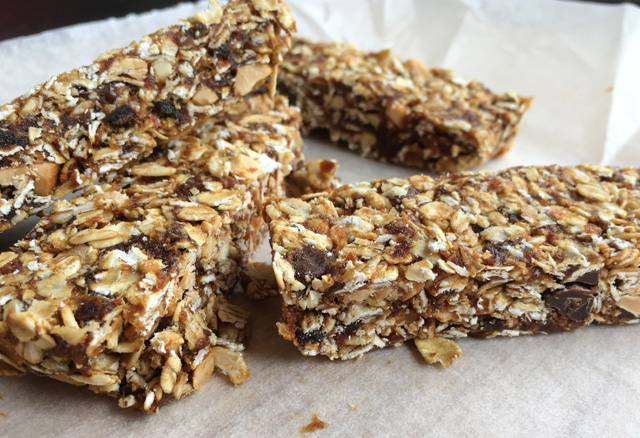 A pile of Simple Nutty Granola Bars on parchment paper