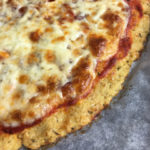 Close up of edge of cauliflower pizza