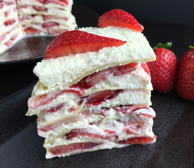 Close-up of a piece of Strawberry Cloud Crepe Cake
