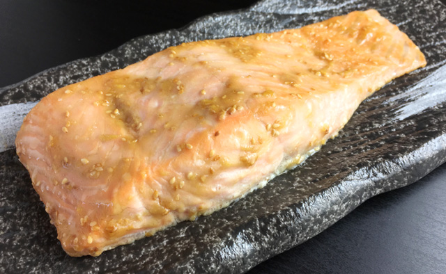 A broiled miso salmon filet on a platter