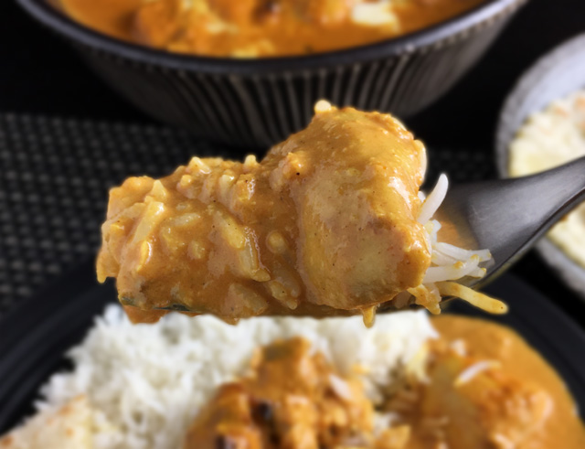 A forkful of Creamy Butter Chicken