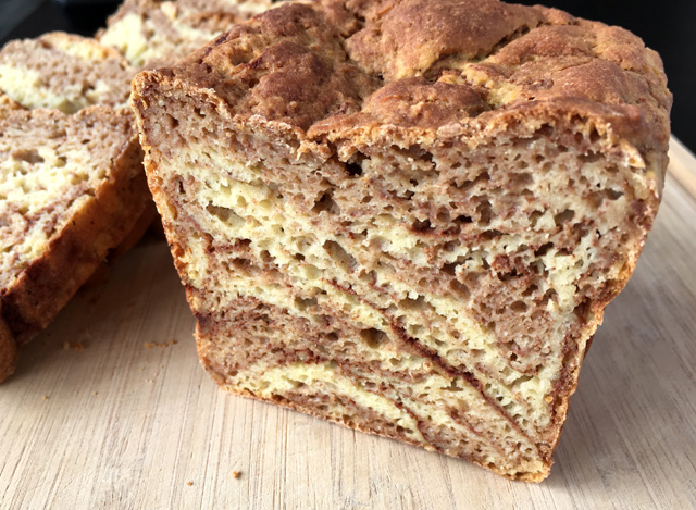The cut face of a loaf of Gluten-Free Cinnamon Marble Bread