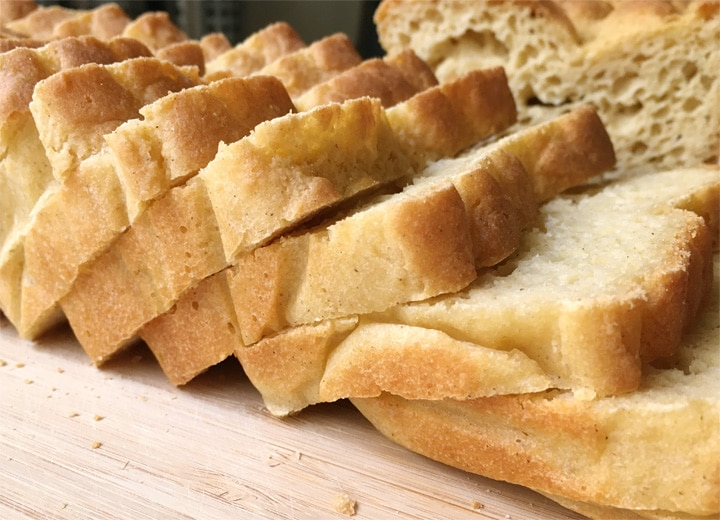 Close-up of slices of bread on a wooden cutting board
