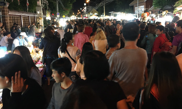 More crowds of people in the street at the Sunday Night Market in Chiang Mai