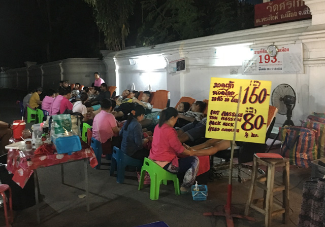 People getting foot massages at the Sunday Night Market in Chiang Mai