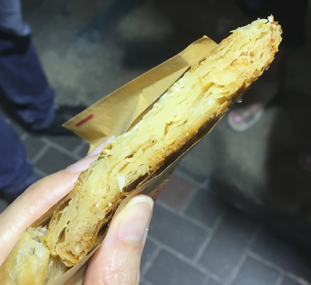 Close-up of the layers in a Sichuan pancake on a Hong Kong foodie tour