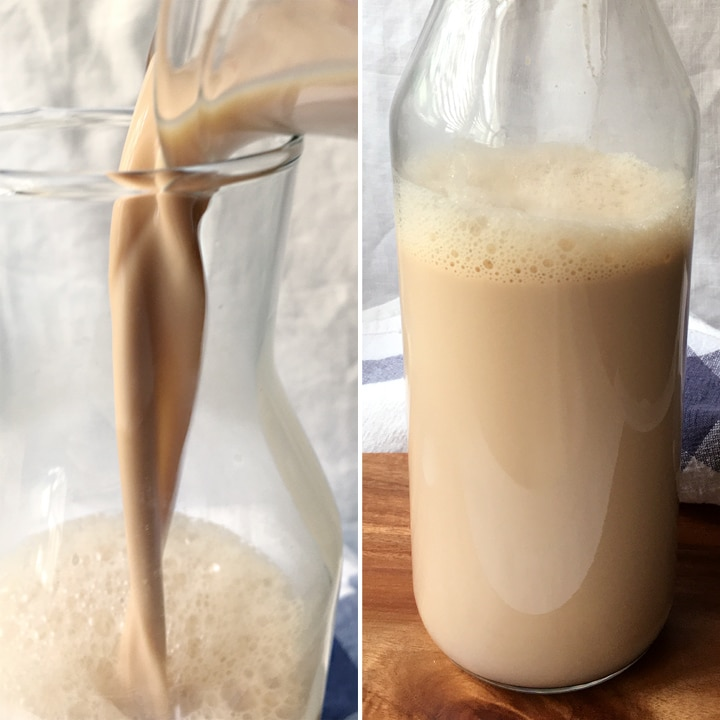 Light brown tea latte being poured into a glass bottle