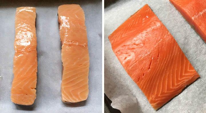Orange salmon filets on parchment paper