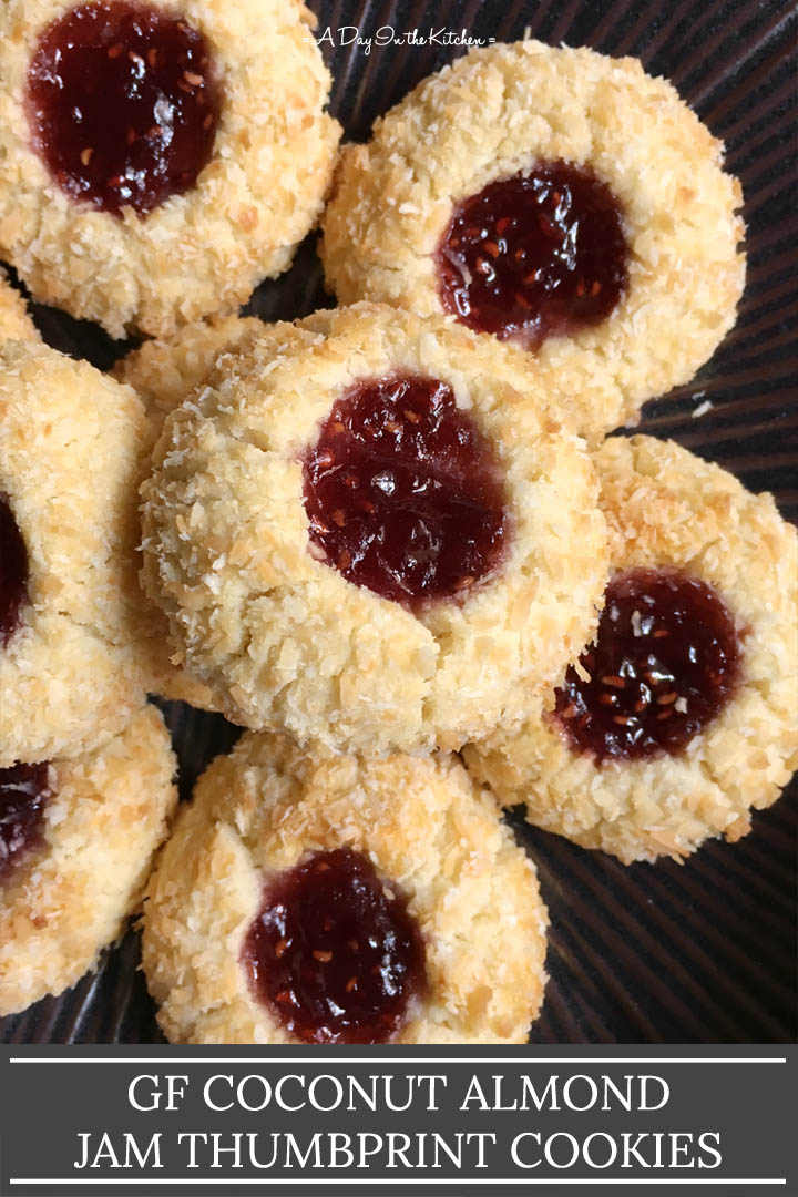 A brown plate containing jam filled cookies, the words coconut almond jam thumbprint cookies on the bottom