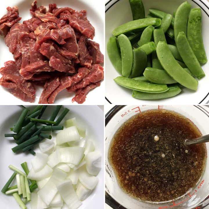 Slices of raw beef, green sugar snap peas, chopped onions, and measuring cup containing brown sauce